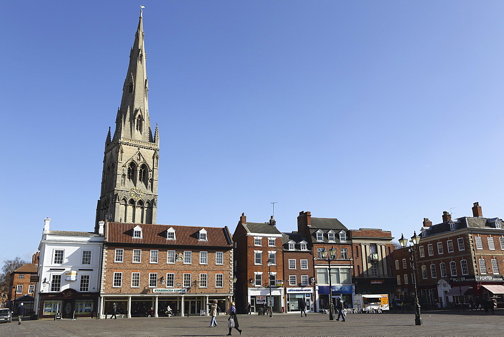 The spire of St. Mary Magdalene church rises over building on the Market Square in Newark-upon-Trent, Nottinghamshire, England, United Kingdom, Europe - 826-622