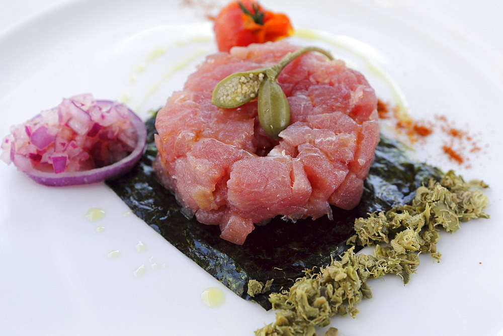 Red tuna tartare with oilive oil, a fig and onion served in Monopoli, Apulia, Italy, Europe