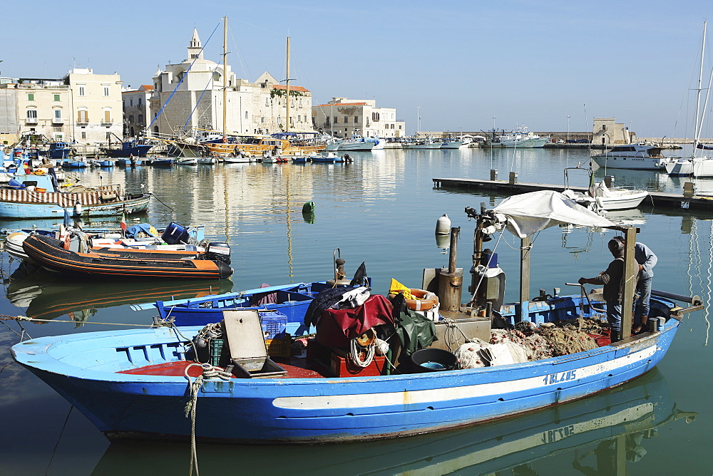 A fishing boat in the harbour by the cathedral of St. Nicholas the Pilgrim (San Nicola Pellegrino) in Trani, Apulia, Italy, Europe - 826-647