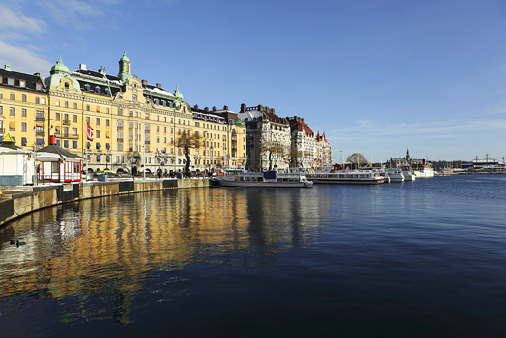 Waterfront buildings at Strandvagen, overlooking boats at Nybroviken, in Stockholm, Sweden, Scandinavia, Europe