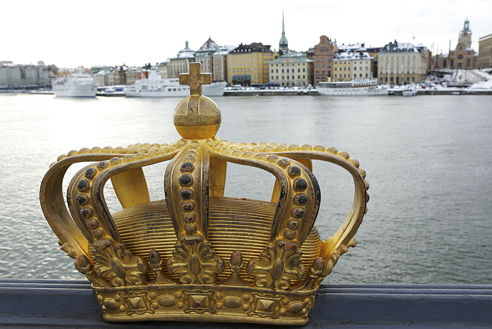 A gilded Swedish crown on the Skeppsholm Bridge (Skeppsholmsbron) in Stockholm, Sweden, Scandinavia, Europe