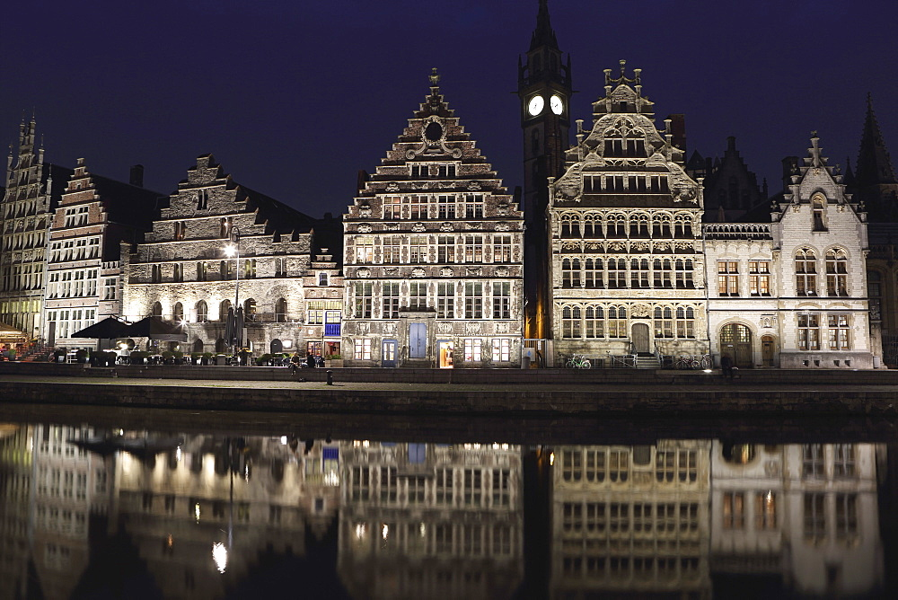 Gothic buildings on the waterfront Graslei reflect in the Leie canal, at night in central Ghent, Belgium, Europe - 826-664