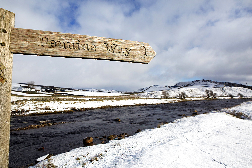 Sign for the Pennine Way walking trail on snowy landscape by the River Tees, Upper Teesdale, County Durham, England, United Kingdom, Europe - 826-665