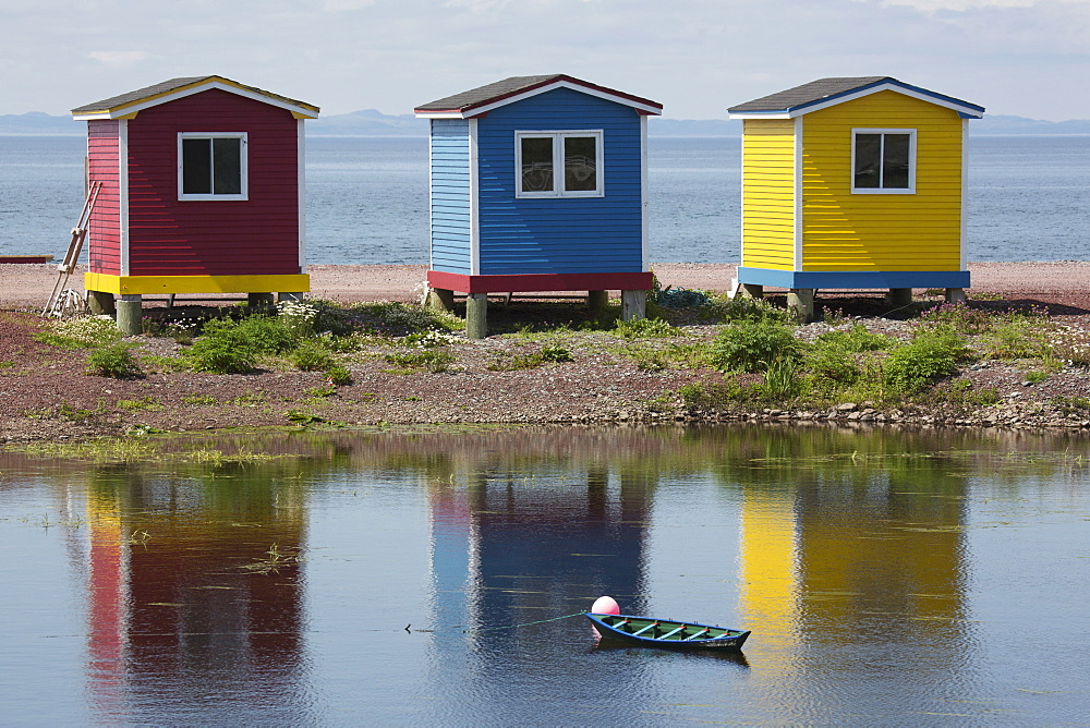 Colourfully painted huts by the shore of the Atlantic Ocean at Heart's Delight-Islington in Newfoundland and Labrador, Canada, North America