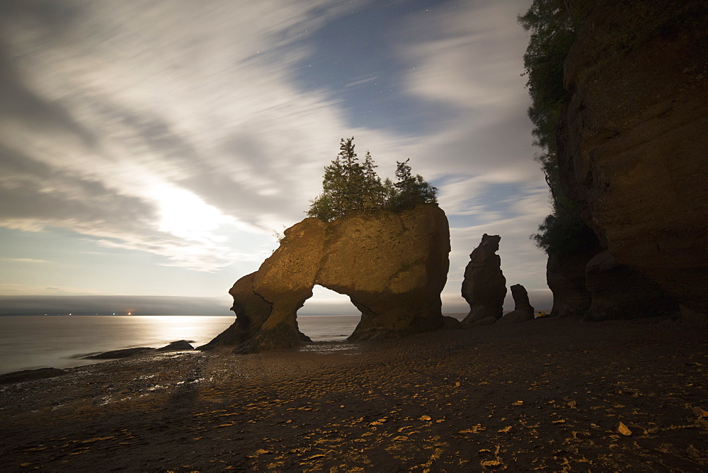 Hopewell Rocks, the flowerpot rocks, on the Bay of Fundy, scene of the world's highest tides, at night in New Brunswick, Canada