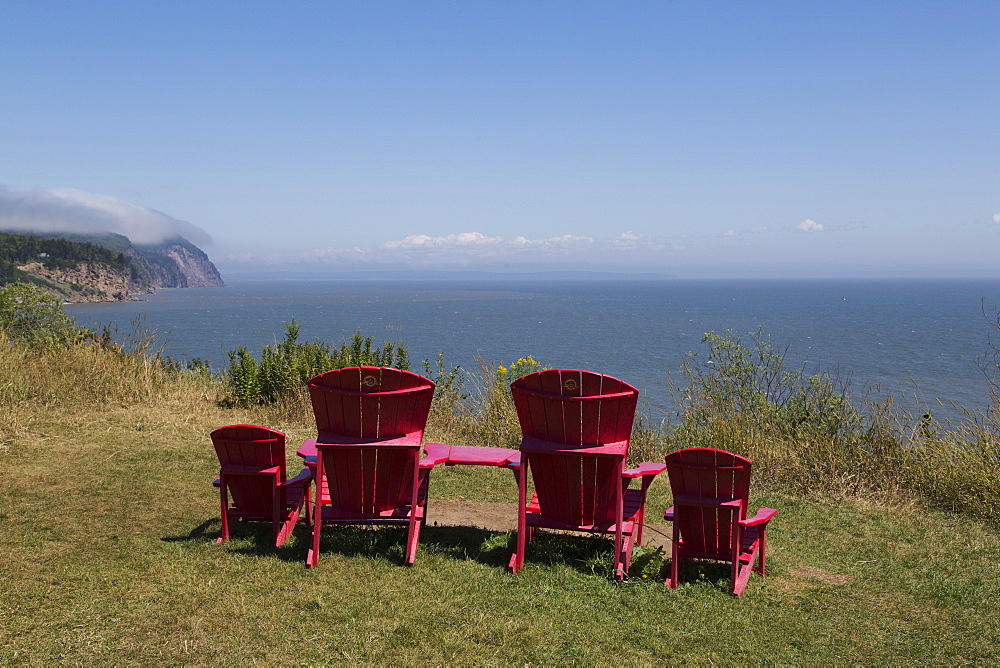 Parks Canada's red chairs at Fundy National Park, overlooking the Bay of Fundy, in New Brunswick, Canada, North America - 826-684