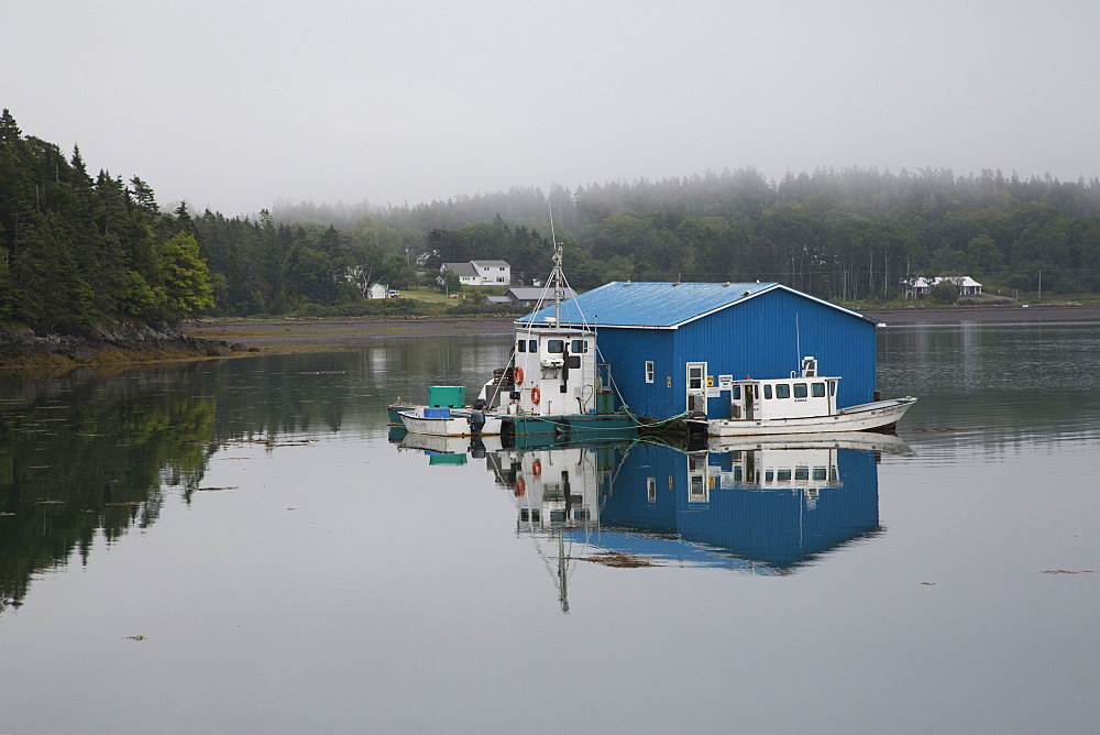 Floating dock, on a foggy day, at Welshpool on Campobello Island in New Brunswick, Canada