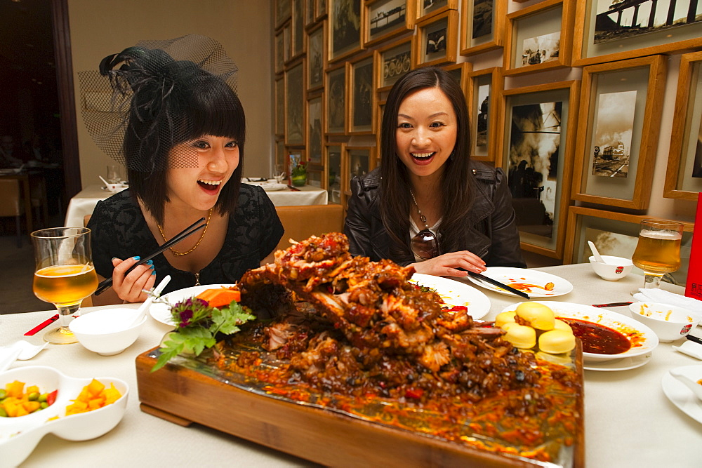 Tourists surprised by the food in a Sichuan cuisine restaurant, Haiyongxiang District, Shanghai, China, Asia - 827-236