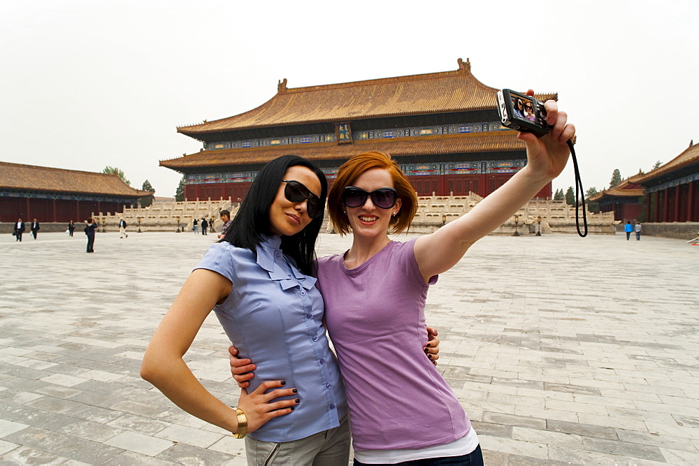 Tourists taking their own photograph in front of the Hall for Worship Of Ancestors, The Forbidden City, Beijing, China, Asia