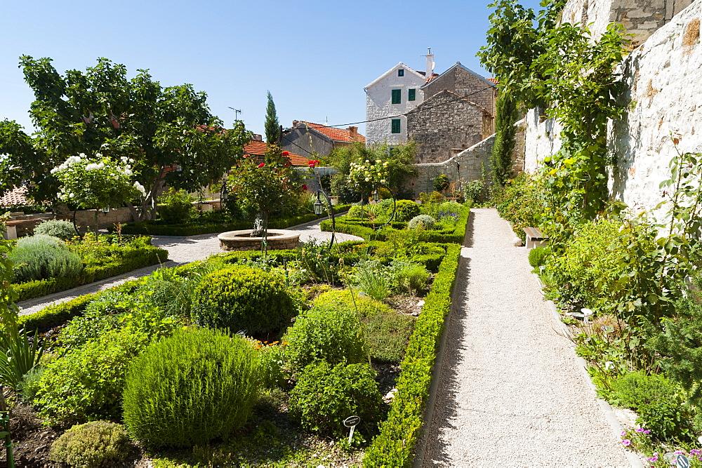 Medieval mediterranean garden of St. Lawrence Monastery, Sibenik, Dalmatia region, Croatia, Europe - 827-476