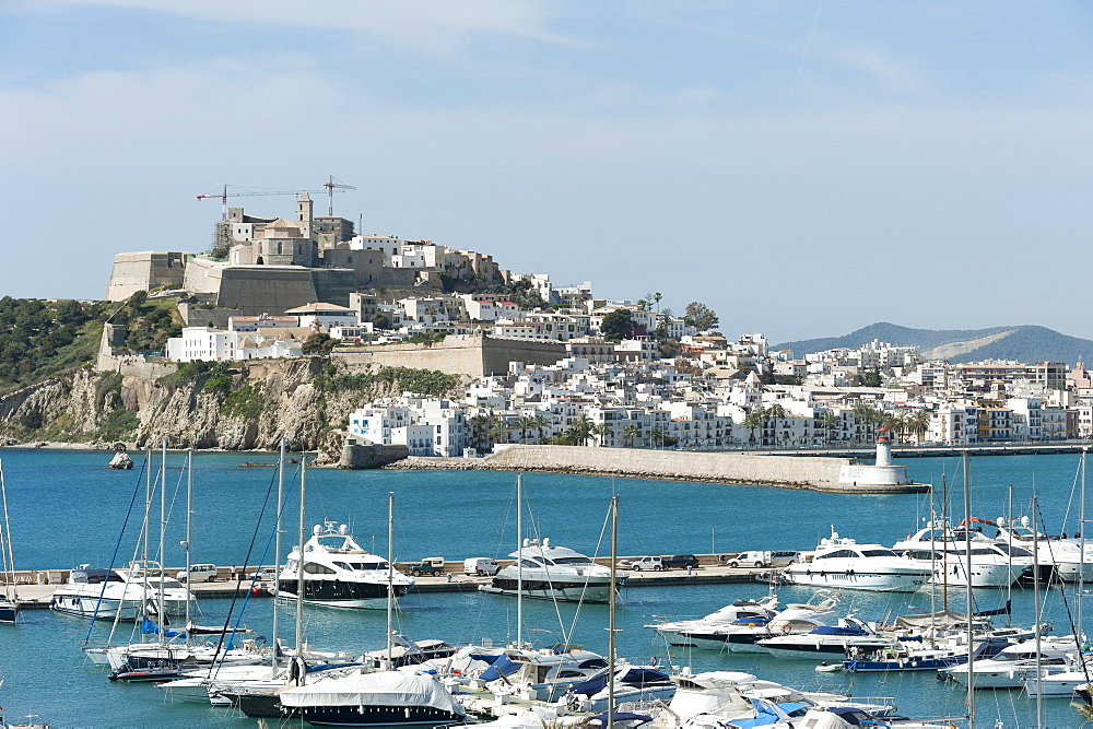 Cranes at Ibiza Castle and view of the boats, Ibiza port, Dalt Vila, Old Town, Ibiza, Balearic Islands, Spain, Mediterranean, Europe - 827-502
