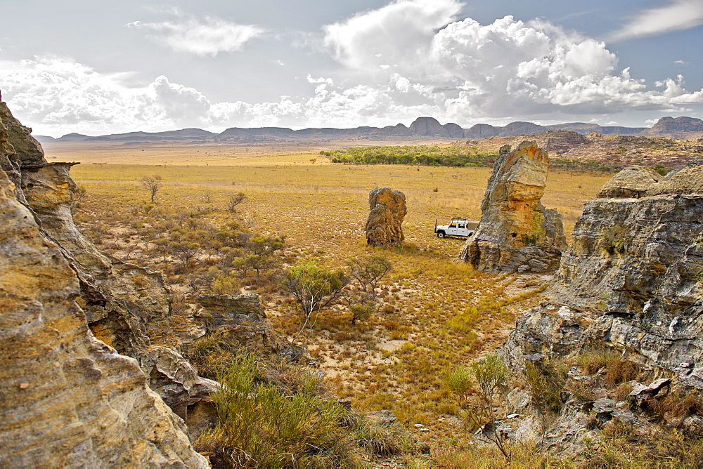 Land Rover parked on the plains of Isalo National Park, a region of the park on the Malaso circuit, southern Madagascar, Madagascar, Africa