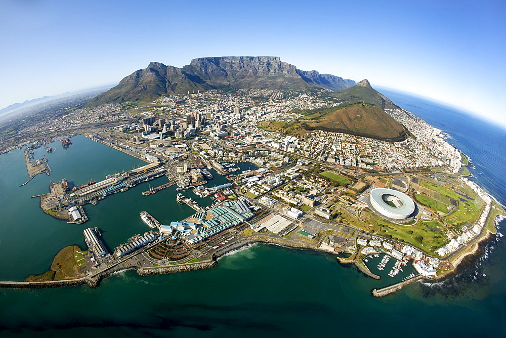 Aerial view of Cape Town showing Table Mountain, with Devil's Peak on the left, Lion's Head and Signal Hill on right, and the new Green Point stadium in the foreround, Cape Town, South Africa, Africa - 829-1104