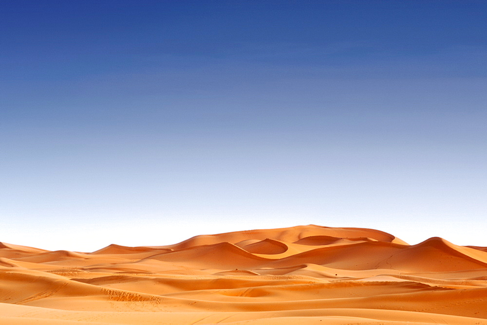 The sand dunes of Erg Chebbi near the town of Merzouga on the periphery of the Sahara desert in eastern Morocco at dawn.