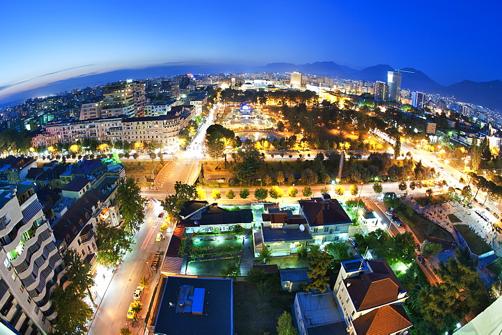Dusk view of city with Rinia Park in the centre, Tirana, Albania, Europe
