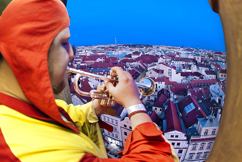 The Prague Trumpeter playing his tune from the Old Town Tower in Prague, Czech Republic, Europe