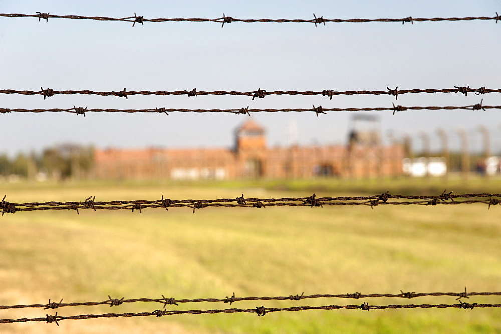 Barbed-wire fencing and buildings at the museum of the former Auschwitz II-Birkenau concentration camp, UNESCO World Heritage Site, southern Poland, Europe