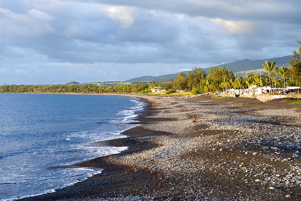 The volcanic coastline and the market at the village of St. Paul on the French island of Reunion in the Indian Ocean, Africa