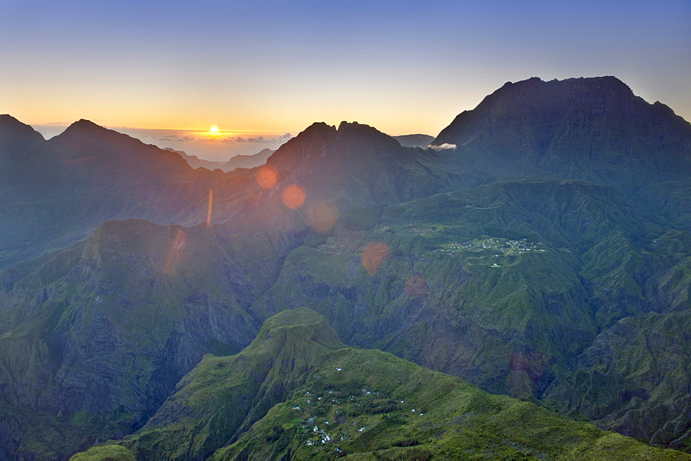 The sun rising over the Cirque de Mafate caldera on the French island of Reunion in the Indian Ocean, Africa