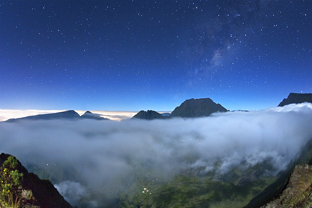 Night-time view across the mist-shrouded Cirque de Mafate caldera on the French island of Reunion in the Indian Ocean, Africa
