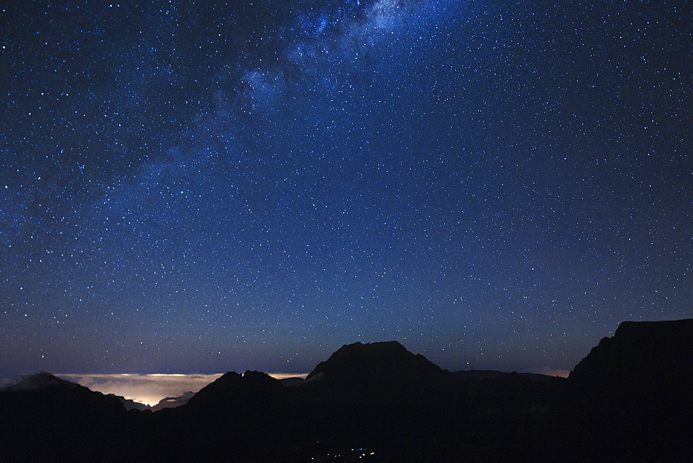 The Milky Way over the mountains encircling the Cirque de Mafate caldera on the French island of Reunion in the Indian Ocean, Africa