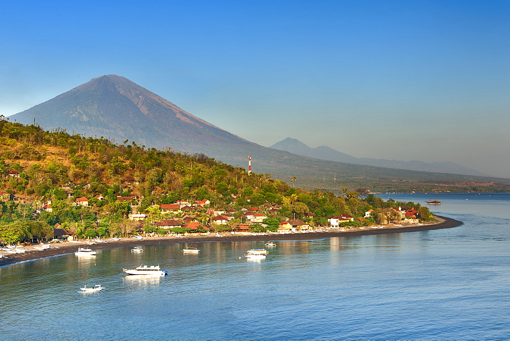 View of Mount Agung (3142m) and Jemulek beach and hamlet near Amed on the northeastern coast of Bali, Indonesia.