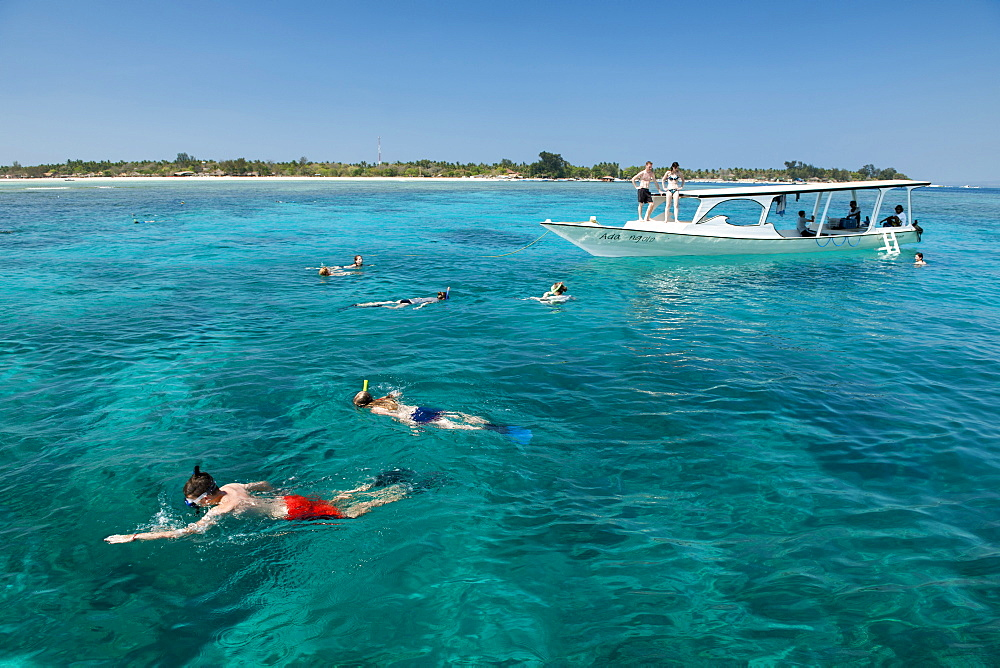Tourist boat with snorkelers off the coast of Gili Air island in Indonesia. - 829-2128