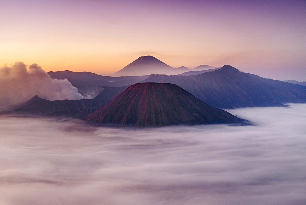 Dawn view of Mount Bromo (near left) and Gunung Semeru (centre background) in Bromo Tengger Semeru National Park, Indonesia.