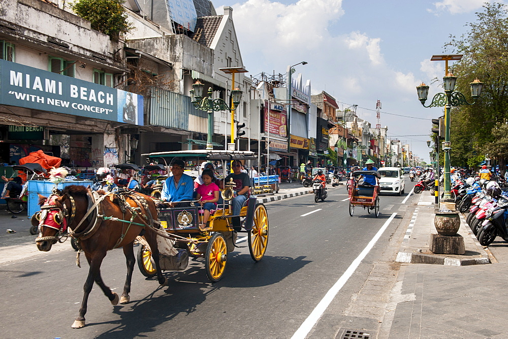 Horse drawn carriage on Jalan Malioboro, one of the main avenues in Yogyakarta, Java, Indonesia.