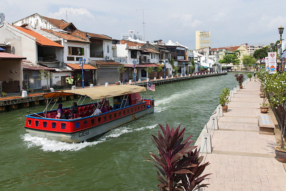 A boat on the Malacca River which flows through Malacca town, Malaysia.