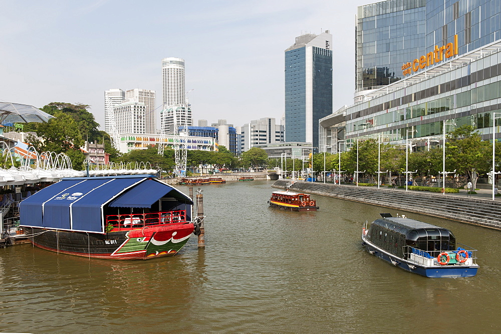 Boats on the Singapore river at Clarke Quay in Singapore.