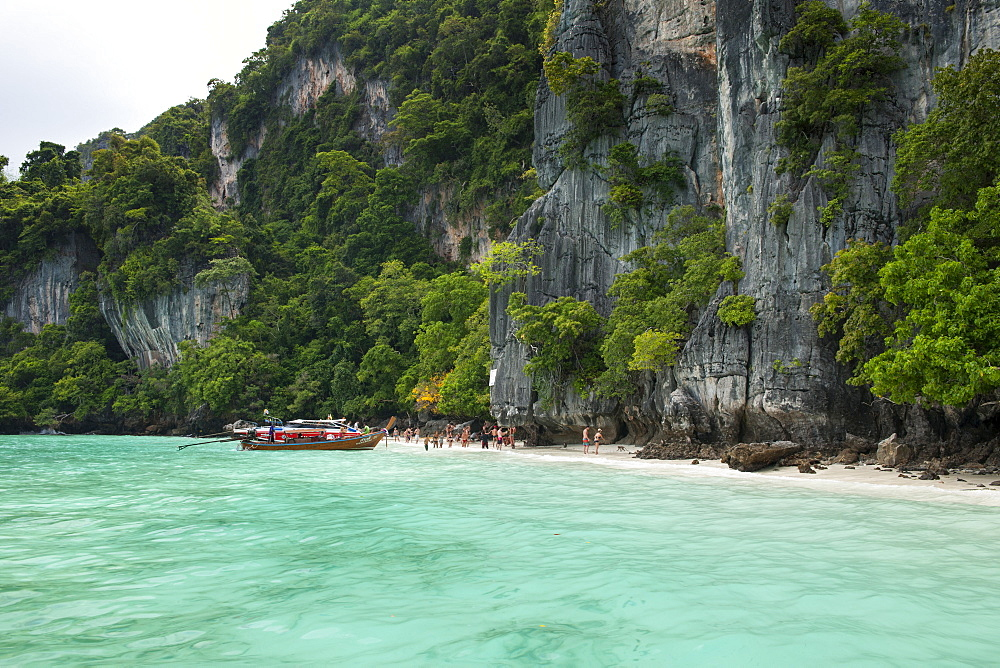 Tourist boats and the coast of Koh Phi Phi island in Thailand.