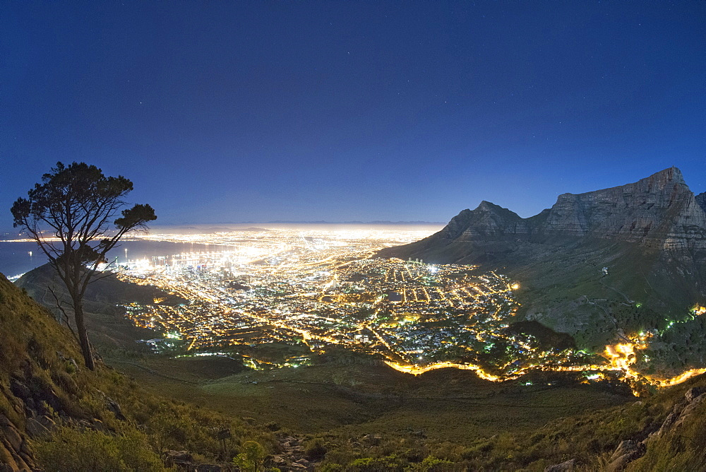 Table Mountain and the city of Cape Town in moonlight.