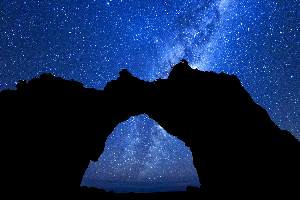Milky Way seen through the outline of the Wolfberg Arch in the Cederberg Mountains of South Africa.