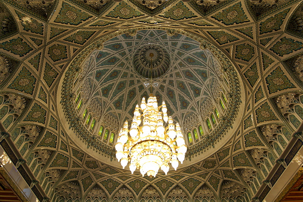 Chandelier and roof inside the prayer area of the Sultan Qaboos Grand Mosque in Muscat, the capital of Oman.