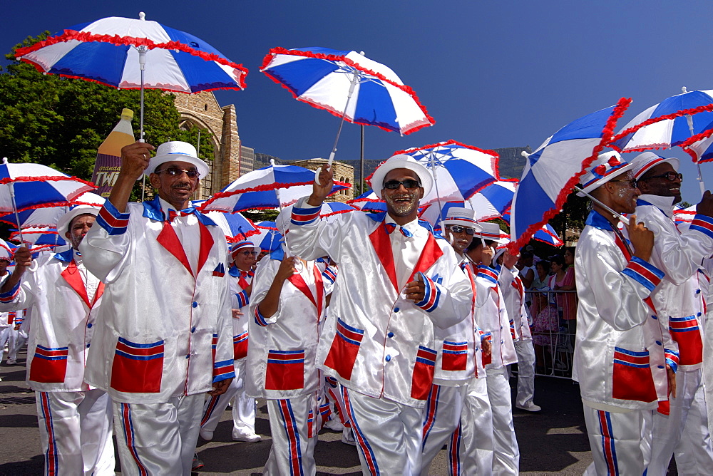 Participants in the annual Minstrels procession (also referred to as the Coon Carnival) in Cape Town. - 829-832