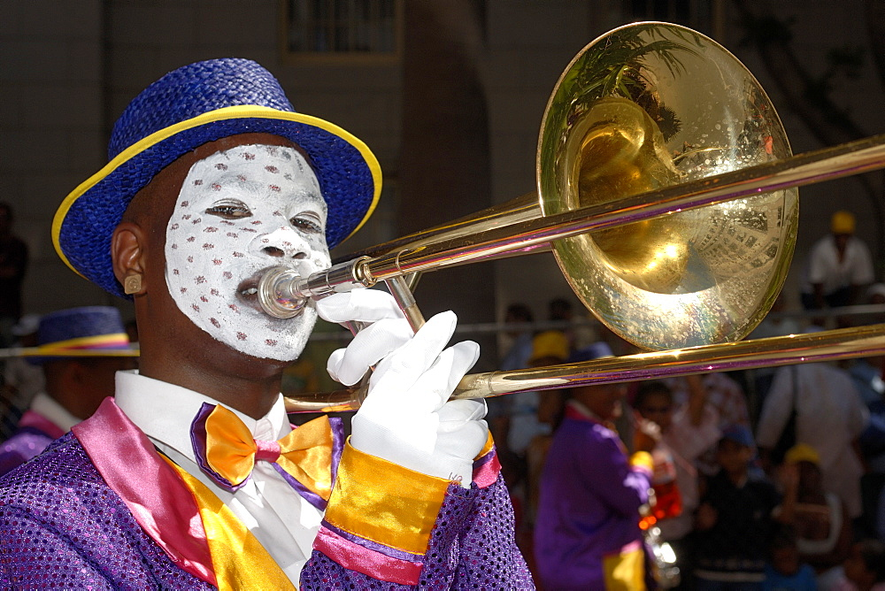 Participant in the annual Minstrels procession (also referred to as the Coon Carnival) in Cape Town. - 829-835