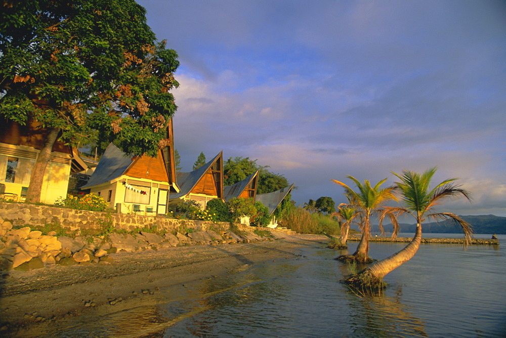 Toba Batak style cabins at Le Shangri-La resort near Ambarita on Samosir Island, Lake Toba, Sumatra, Indonesia, Southeast Asia, Asia