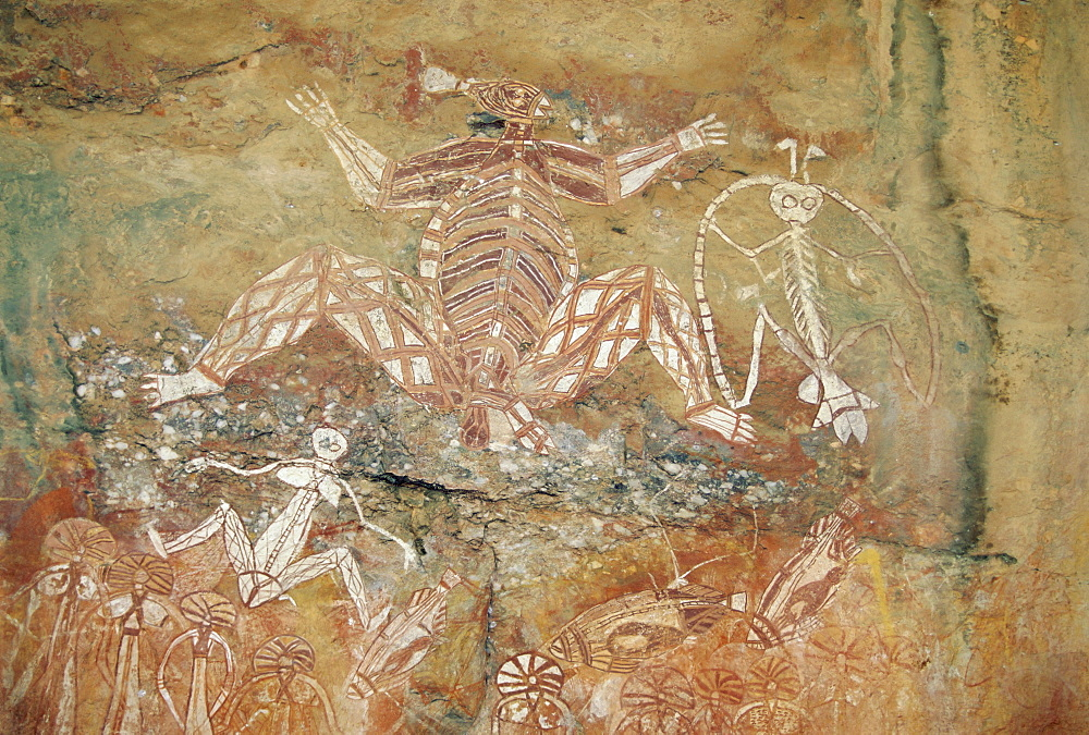 Namondjok (centre) who ate his clan sister, Namarrgon (right) , the Lightning Man and Barrginj his wife (below left) supernatural ancestors at the rock art site at Nourlangie Rock, Kakadu National Park, Northern Territory, Australia