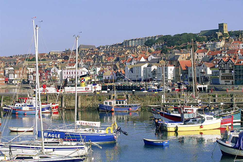 Boats in harbour and seafront, Scarborough, Yorkshire, England, United Kingdom, Europe