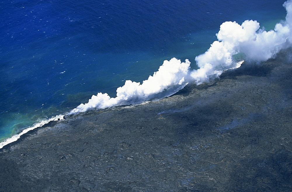 Steam cloud rising where lava from the Pu'u O'o cinder cone far inland enters sea on southeast Puna coast near Kaimu, Big Island, Hawaii, Hawaiian Islands, United States of America, Pacific, North America