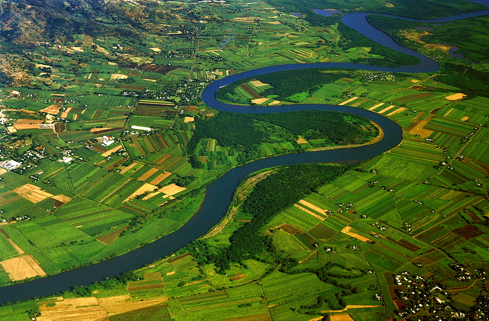 Aerial view of the north west coast of Viti Levu between Nadi and Lautok, Viti Levu, FijiPatchwork fields of sugar cane and other crops around the Ba River near the major sugar town of ba in the north west. Higher up, the Ba is famous for it's white water rafting.