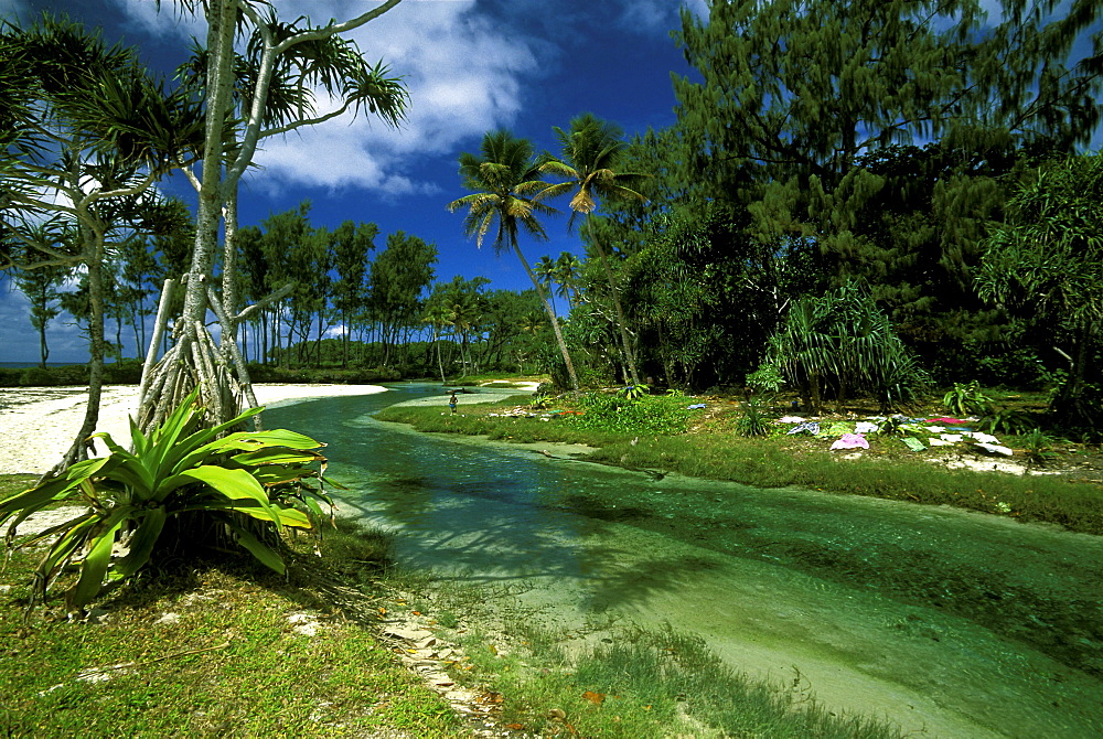 Typically clear river at the white sand beach at Eton in the south east of Efate Island, Efate Island, Vanuatu