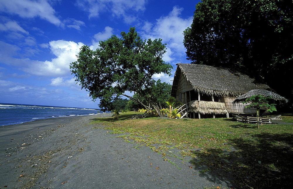 Bamboo beach hut on volcanic 'black sand' beach in East Tanna near Mt Yasur, one of the Pacific's most active volcanoes, Tanna Island, Vanuatu