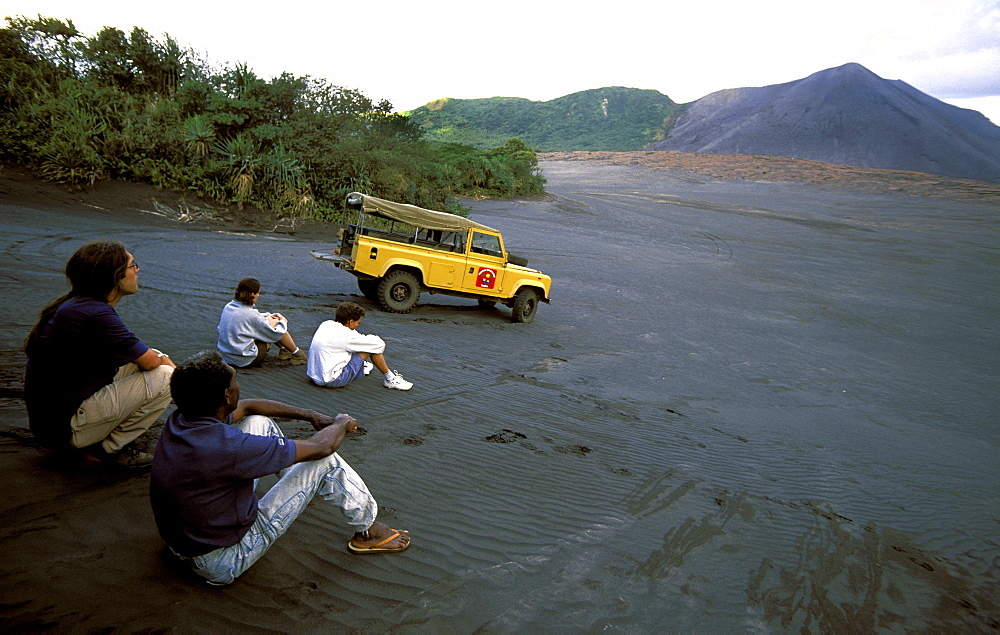 Tourists on the ash plain of Mt Yasur in east Tanna, one of the Pacific's most accessible & active volcanoes, Tanna Island, Yasur Volcano, Vanuatu