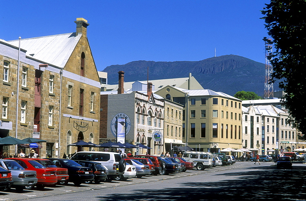 Sandstone warehouses converted to cafes, galleries and shops, with 1270m Mount Wellington beyond, at popular Salamanca Place,  Hobart, Tasmania, Australia, Pacific