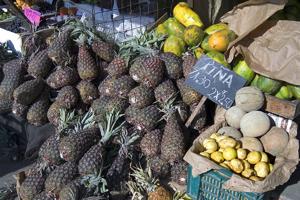 Pineapples, papaya, melons, and passionfruit at the market of this vibrant commercial and historic centre in the north, Puira, Peru, South America