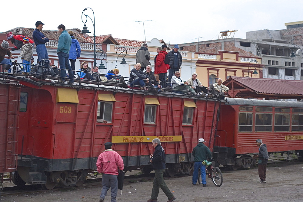 Roof-top tourists await the departure of the famous train ride to the Nariz del Diablo (The Devil's Nose) from this major transport and tourist hub, Riobamba, Chimborazo Province, Central Highlands, Ecuador, South America