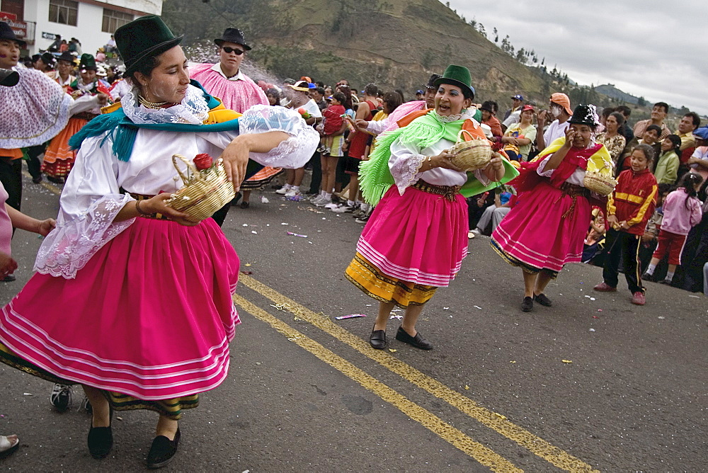 Dancers in traditional clothing at Carnival, one of the biggest in Ecuador, in the town of Guaranda, Bolivar Province, Ecuador, South America