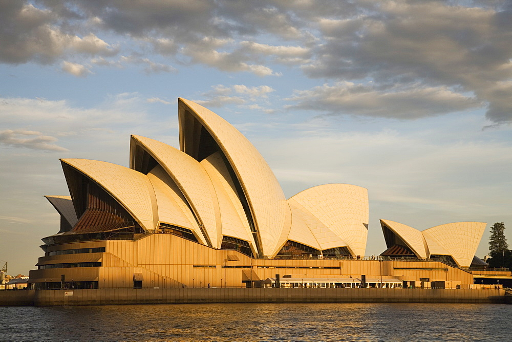 Sydney Opera House built in 1973, designed by Jorn Utzon, at Circular Quay, viewed at sunset, Sydney, New South Wales, Australia, Pacific